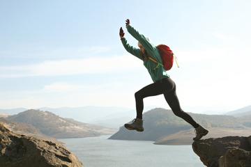 jumping across mountain